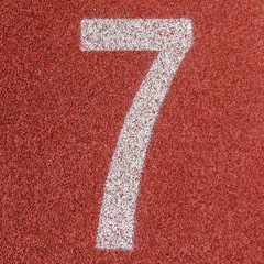 """""""7"""" Numbers on red running track"""