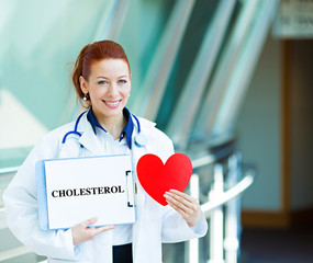 Doctor holding heart and cholesterol sign