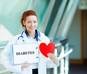 Portrait female doctor holding diabetes sign and heart