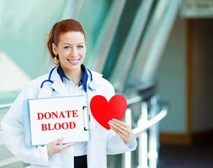 Doctor blood banker holding donate blood sign