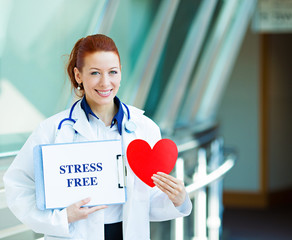 Female doctor with stresss free sign and red heart in hospital