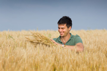 Happy man in wheat field