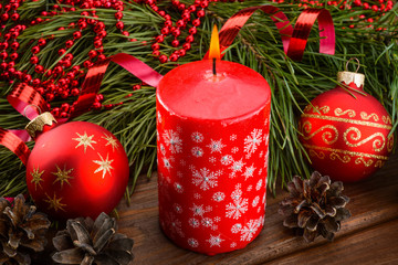 red candle and Christmas balls