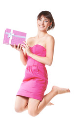Jumping young woman take the gift box