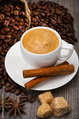 Coffee cup with coffee beans and sugar