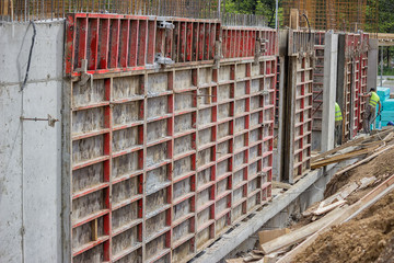 Building construction site with formwork elements