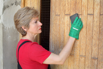 Worker prepare plank, wood with sanding sponge block