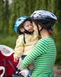 Mother and son wearing bicycle helmets laughing