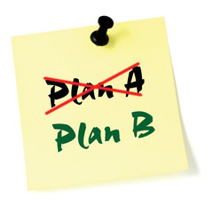 Crossing out Plan A, writing Plan B, Yellow Post-It Style Sticky