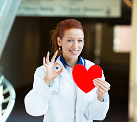 Doctor holding heart giving ok sign