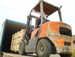 Electric Forklift Loading Cargos into Container