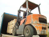 Electric Forklift Loading Cargos into Container - 66450392