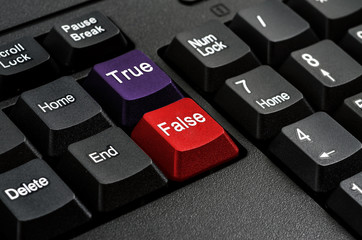 Computer keyboard keys labeled True and False