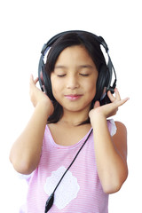 Asia girl wearing headphones on white background