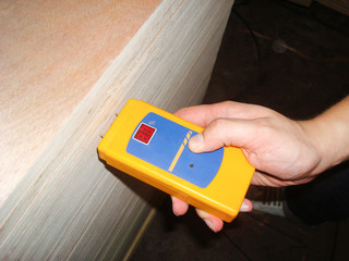Worker Measuring Level of Moisture Density for Quality Assurance