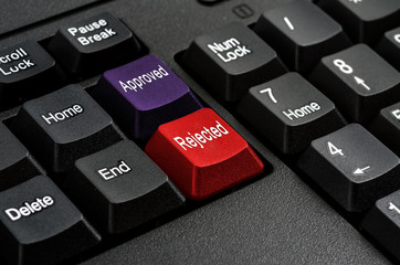 Computer keyboard keys labeled Approved and Rejectd