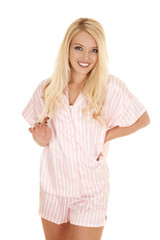 woman blond pajamas standing smile hold hair