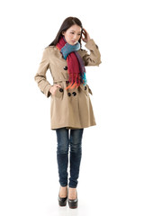 Asian lady with coat in winter