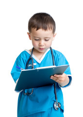 Child boy uniformed as doctor writing to clipboard