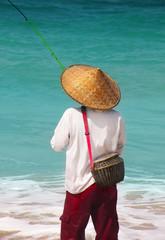 Fisherman fishing on the coast
