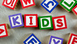 Wooden blocks forming the word KIDS in the center