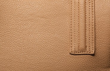 Brown leather with seam.