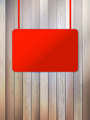 Blank red signboard on aged wooden wall. EPS10