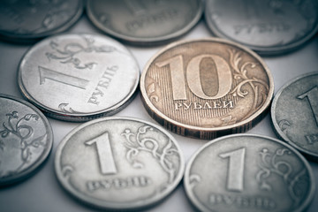 Pile of russian coins. Selective focus on ten rubles.