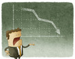 Businessman standing in front of a declining stock chart