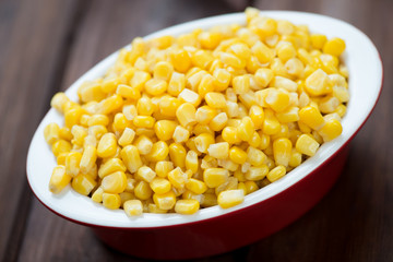 Glass bowl with sweet corn kernels, horizontal shot