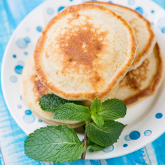 Pancakes with mint on a glass plate, studio shot, close-up