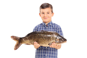 Little boy holding a big fish