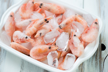Iced shrimps in a glass bowl, close-up, high angle view