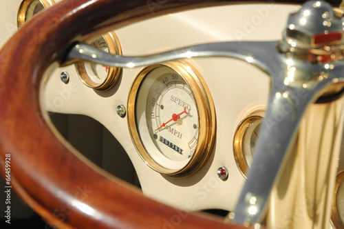 speedometer dial and steering wheel on a retro auto