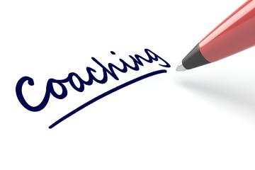 Stift schreibt das Wort Coaching