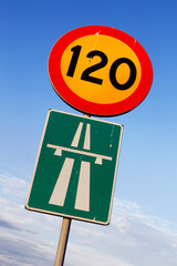 Speed limit 120 and motorway signs