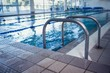 Swimming pool with hand rails - 66461501