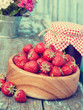 strawberries in wooden bowl and jam