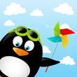 Funny penguin with paper pinwheel