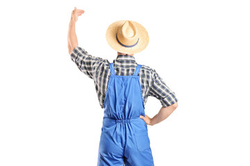 Male farmer gesturing with hand