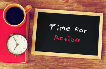 clock, coffee cup and blackboard with the phrase time for change