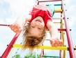 Leinwanddruck Bild - Happy child on a jungle gym