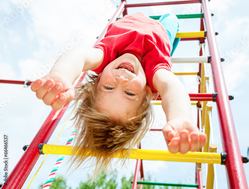 Leinwanddruck Bild Happy child on a jungle gym
