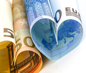 Two euro bill in the form of a heart
