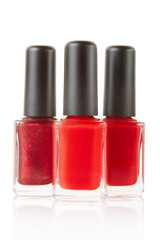 Red nail polish bottles group on white, clipping path