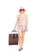 Blond woman walking with her luggage