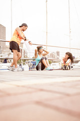 Mixed group of runners sharing a water break after exercise