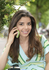 Pretty Girl using her mobile phone
