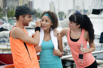 Three friends listening to music while exercising