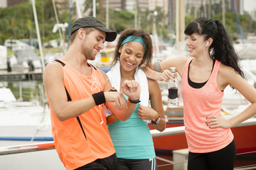 Three young friends chatting about their exercise gear